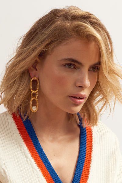 Thumbnail of model wearing Vine Earrings. You'll be the strongest link in the style chain in these textured, gold-plated brass long link earrings with freshwater pearl details.