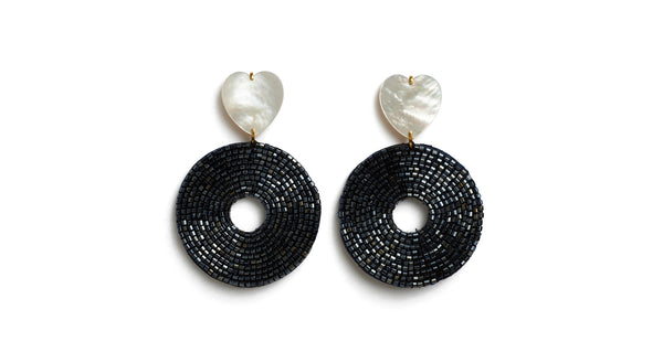 Full view of Starlet Earrings. A star(let) is born. You'll be sure to cut a dramatic figure in the mother-of-pearl heart earrings with gunmetal hand-beaded circular discs.