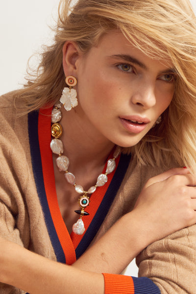 Thumbnail of model wearing Monte Carlo Flower Earrings. Flower power! We really can't think of a prettier take on the classic art of carved shell jewelry. Mother-of-pearl etched flower earrings dangle from circular pink and peach enamel tops.