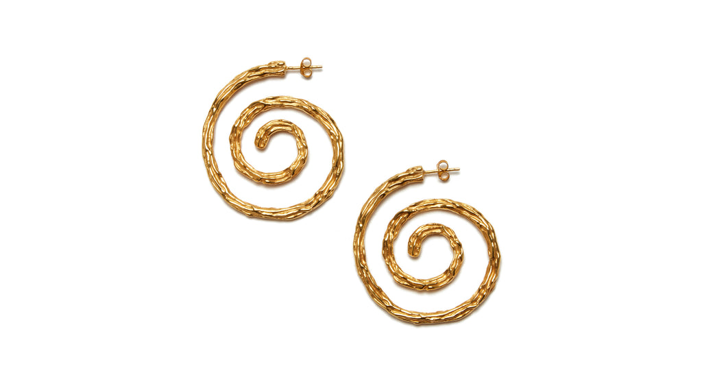 Full view of Spiral Earrings. We can't help but be captivated by the hypnotic spiral shape and organic texture of these earrings. We also love how they evoke the feel of both a '90s supermodel and the world's coolest art teacher.