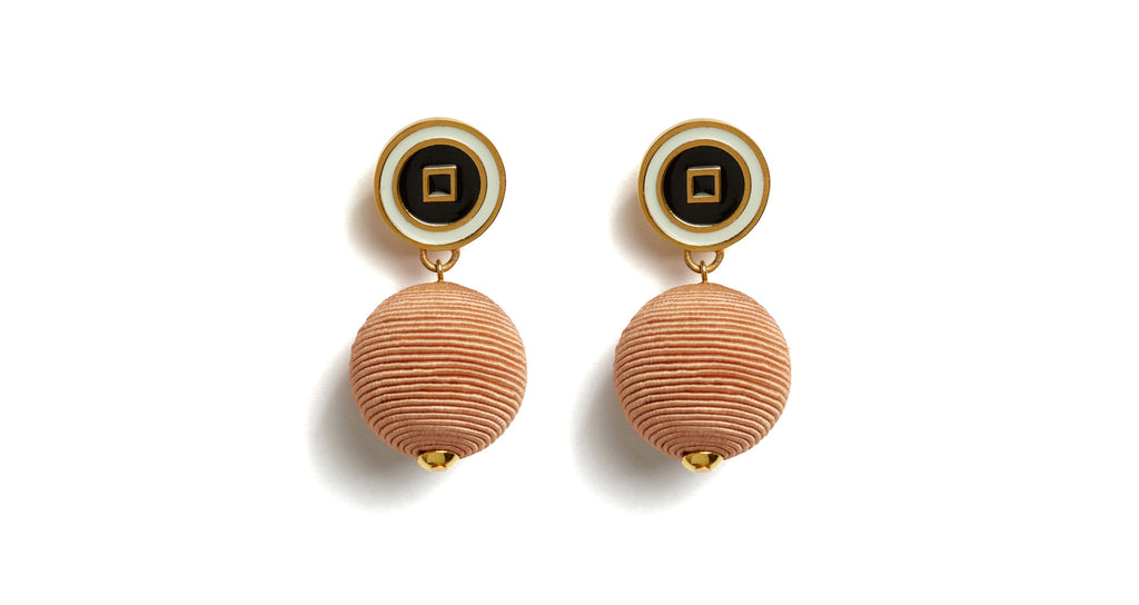 "Full view of Corte Earrings. Right on style target: you'll cut a fine form in these peach silk cord drop earrings with cream and black enameled ""bull's eye"" tops."