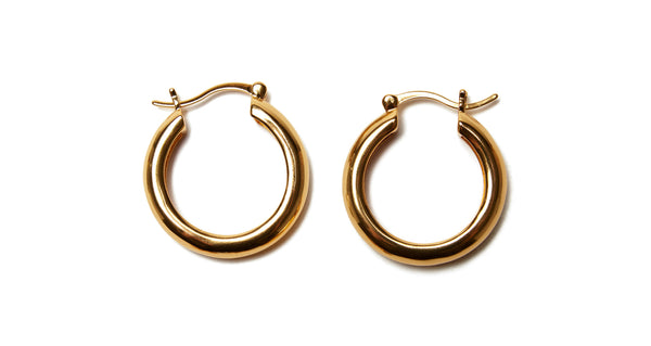 Side by side view of Large Gold Mood Hoops. First, base: shop these large gold-plated hoop earrings. Although classic in their own right, we recommend using them as the foundation for mixing, matching and layering our charms. An endless assortment of unique earring combinations awaits you!