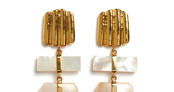 Top detail of Botticelli Earrings. Pretty as a painting. Get ready to shine in linked statement earrings with gold-plated shell and mother-of-pearl charms that remind us of textured brush-strokes.