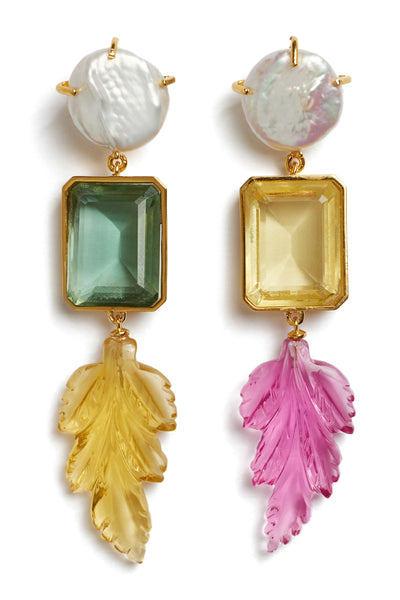 Thumbnail close-up of Joyride Earrings. Take these beauties out for a spin and be prepared for compliments. Asymmetric multicolored column earrings with baroque pearl tops, faceted quartz baguettes, and carved leaf charms in lemon topaz and rubelite quartz.