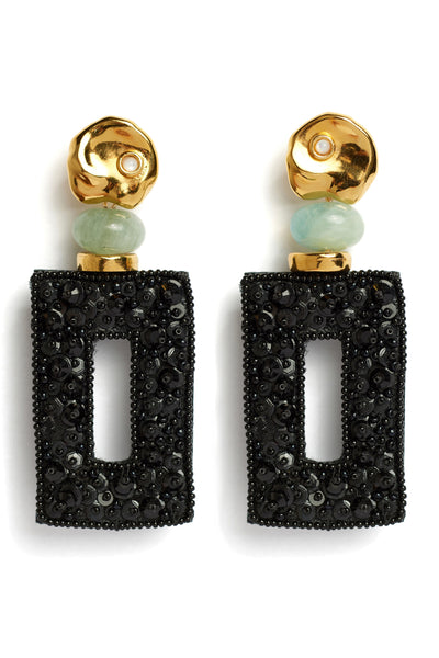 "Thumbnail close-up of Globetrotter Earrings. Ready for non-stop sophistication? You'll have the world at your feet in the gold-plated ""coin"" top earrings with tiny pearl cabochons and aquamarine morganite. The black rectangular panels are hand-sewn with crystal beads for a unique look fit for the style jet-setter."