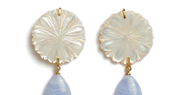 Top detail of Wild Maquis Earrings. Lizzie's explorations of the uniquely fragrant hillsides of Italy was the inspiration for these beautiful hand-carved mother-of-pearl flower earrings. They feature hanging blue lace agate drops that catch the light in the most perfect way