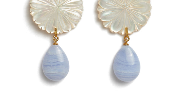 Bottom detail of Wild Maquis Earrings. Lizzie's explorations of the uniquely fragrant hillsides of Italy was the inspiration for these beautiful hand-carved mother-of-pearl flower earrings. They feature hanging blue lace agate drops that catch the light in the most perfect way.