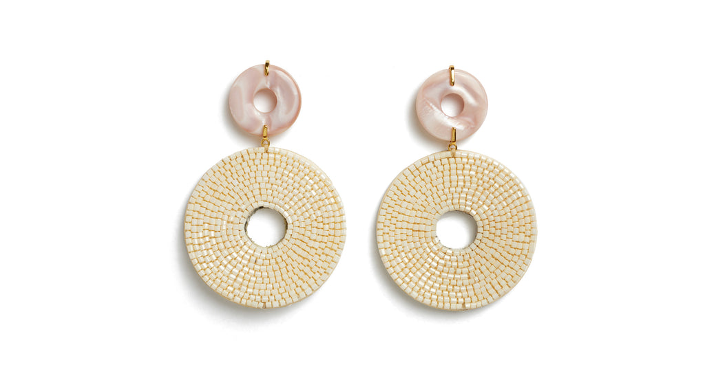 Full view of Soleil Earrings. Time to glow! You'll emit some major old-Hollywood style wattage in our pink mother-of-pearl earrings with over-sized hand-beaded circular discs in white.