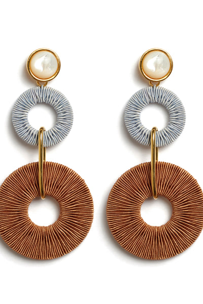 Thumbnail close-up of Corsica Column Earrings. Get linked in with our fashion-forward statement earrings. Pale blue and brown woven hoops are linked with mother-of-pearl tops for a fun, elevated arts & crafts vibe.