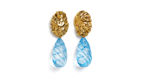 Full view of Whirlpool Earrings. Proof that blue is the warmest color. You'll heat things up in our gold-plated organic shell earrings with large light blue transparent drops.