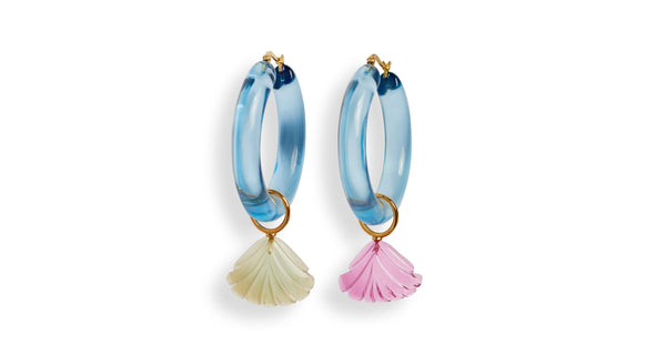 Full view of La Playa Hoops In Sky. Put some spring in your step in our colorful acrylic hoops. Mismatched lemon and hot pink quartz hand-carved charms hang from transparent light blue hoop earrings for a breezily stylish effect.