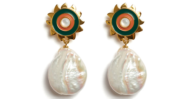 Close-up view of Sunlit Earrings. Here comes the sun. Graphic forest green and carnelian enameled sunshine earrings meet with the organic swirl of freshwater pearl drops.