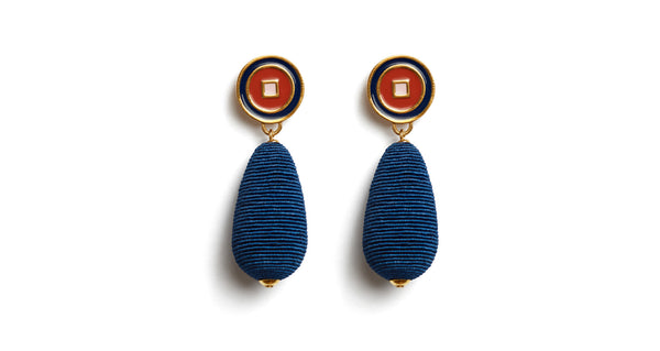 "Full view of Breton Stripe Earrings. Rock the style boat with these deep blue silk cord drop earrings in a lively nautical-inspired palette. With navy, tomato, and pale pink enameled ""bulls eye"" tops."
