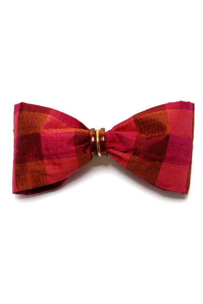 Thumbnail of Good Hair Day Bow In Magenta. The sweetest way to raise the style profile of your everyday ponytail? It's our gold-plated barrette with dark magenta silk shantung bow. With tortoise and gold-plated accents.