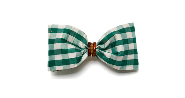 Full view of Good Hair Day Bow In Green. The freshest way to raise the style profile of your everyday ponytail? It's our gold-plated barrette with green gingham silk shantung bow. With tortoise and gold-plated accents.