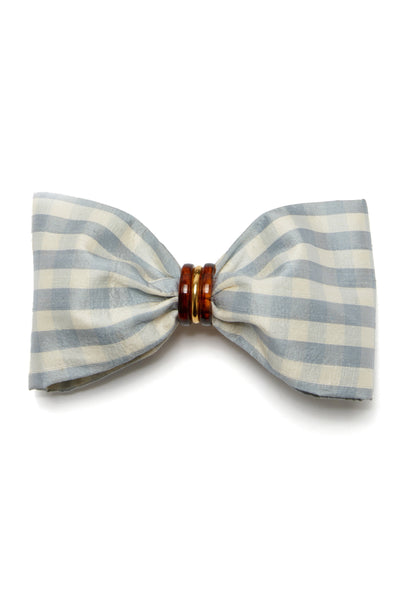Thumbnail of Good Hair Day Bow In Pale Blue. The easiest way to raise the style profile of your everyday ponytail? It's our gold-plated barrette with pale blue gingham silk shantung bow. With tortoise and gold-plated accents.