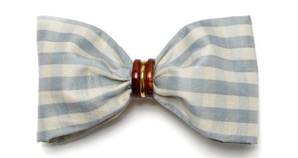 Close-up view of Good Hair Day Bow In Pale Blue. The easiest way to raise the style profile of your everyday ponytail? It's our gold-plated barrette with pale blue gingham silk shantung bow. With tortoise and gold-plated accents.