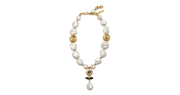 "Full view of Apollo Pearl Necklace. Whether you're a beach babe or ballet patron (or both!), this keshi pearl necklace will stun. In a cool ""Y"" silhouette with gold-plated nautilus beads and hanging pendant with enamel sunshine charm, black agate and freshwater pearl."