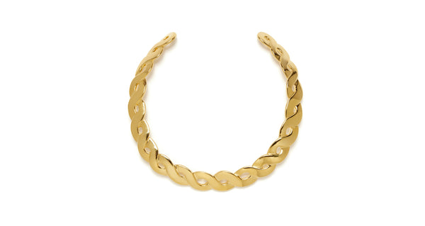 "Full view of Gold Braid Collar. Make a simple but sexy statement in this gold-plated woven ""braid"" collar necklace. It also looks phenomenal paired with our Black Sand Earrings."