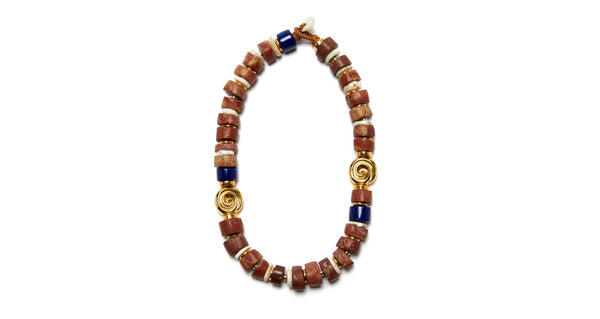 Full view of Terra Necklace. Lizzie does it again, crafting a necklace that is unexpectedly both earthy and super sophisticated. Featuring a single strand of African bauxite, conch shell, and blue Tibetan glass beads, with a shell toggle closure.