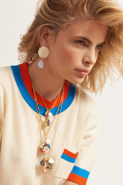 "Thumbnail of model wearing Fortune Necklace In Kaleidoscope. We see beautiful things in your future, like this gold-plated chain necklace with ""kaleidoscope"" pendant in multi-color enamel with a mother-of-pearl cabochon. Accented with a sweet little freshwater coin pearl."