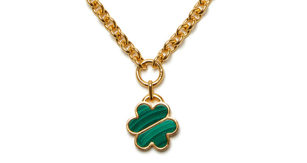 Close-up of pendant on Daisy Chain Necklace In Malachite. Wear it everyday, love it forever. We think this chain-link necklace with malachite inlay daisy pendant is destined to become one of our most iconic layering pieces.