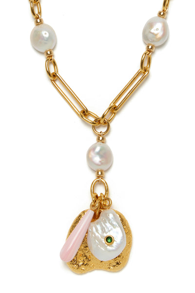 Thumbnail detail of Holiday Charm Necklace. The charm is in the details: Freshwater pearls are delicately woven through the gold-plated chain link necklace, capped off by the perfect layering of oversized gold pendant, pink conch drop, and sculptural pearl inset with a tiny green onyx cabochon.