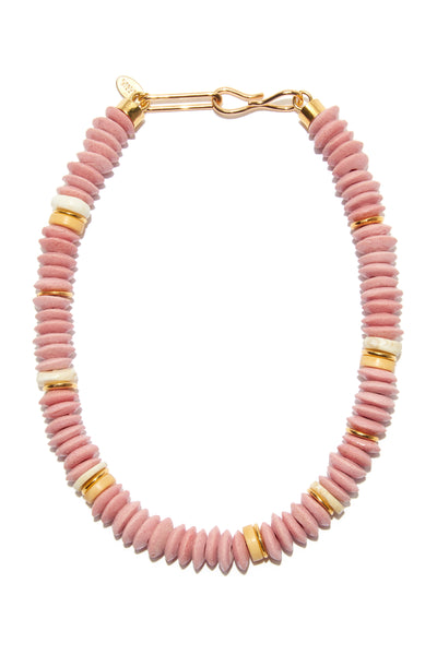 Thumbnail close-up of Laguna Necklace In Rose. Make waves in this bright and blushy take on the classic single-strand necklace. With pink glass, bauxite, and shell beads, this is a website-only exclusive of our popular Laguna design.