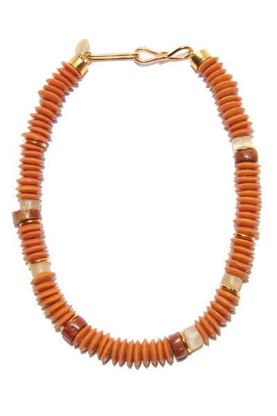 Thumbnail close-up of Laguna Necklace In Coral. Make waves in this fresh tangerine take on the classic single-strand necklace. With orange glass, bauxite, and shell beads, this is a website-only exclusive of our popular Laguna design.
