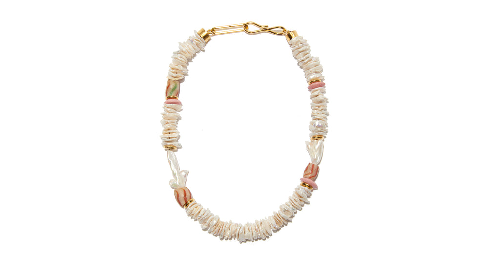 Full view of Laguna Necklace In Garden Pearl. Make waves in this pretty, pearly take on the classic single-strand necklace. With baroque pearl, bauxite, and pink shell accent beads, this is a website-only exclusive of our popular Laguna design.