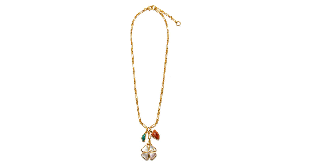 Full view of Bonne Chance Charm Necklace. As luck would have it, we've found your next go-to charm necklace. Gold vermeil chain with bisected mother-of-pearl four leaf clover pendant, with amazonite and coral semiprecious charms.