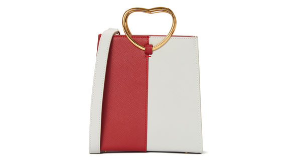 Full view of Pronto Purse In Queen Of Hearts. Heart-shaped handles and bold red and white color-blocking define this one-of-a-kind, statement-making leather mini bag. This is one valentine you can carry with you all year long.