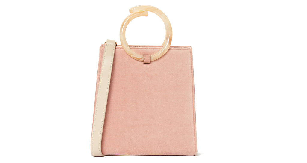 Full view of Pronto Purse In Pink Sands. An impactful and unique update to any outfit. One-o...
