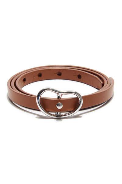 Thumbnail of Skinny Georgia Belt In Tan + Silver. Trust us - you will want to wear this adjustable skinny tan leather belt forever. With silver-plated brass buckle.