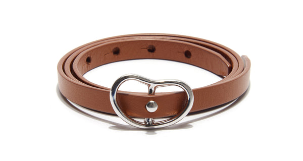 Full view of Skinny Georgia Belt In Tan + Silver. Trust us - you will want to wear this adjustable skinny tan leather belt forever. With silver-plated brass buckle.