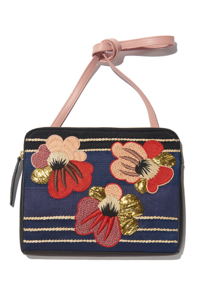 Thumbnail close-up of Safari Clutch In Blooming Poppy. Take me home tonight: one-of-a-kind statement purse seeks bold style maven. This black leather zipper clutch features a red and pink embroidered floral motif and detachable pink leather strap. Good times guaranteed.