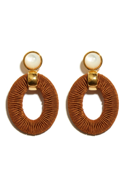 Thumbnail close-up of Harvest Sun Earrings. Get your favorite summer linen ready and throw on these one-of-a-kind gold-plated statement earrings. The woven brown hoops and mother-of-pearl tops combine for a fun, elevated arts & crafts vibe.