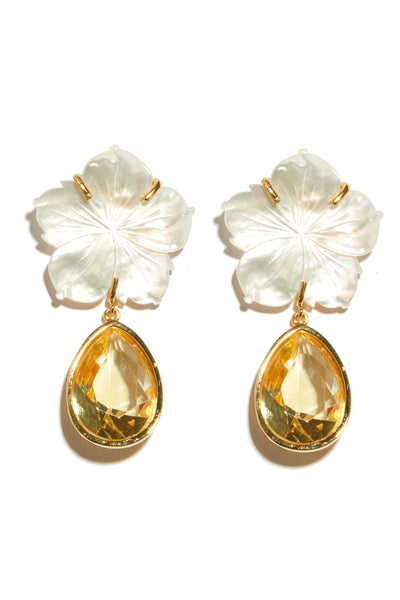 Thumbnail close-up of Paper White Dew Drop Earrings. Inject a shot of vitamin D into your wardrobe! These one-of-a-kind gold-plated earrings feature mother-of-pearl flower tops and lemon faceted glass drops that sparkle like warm sunshine.
