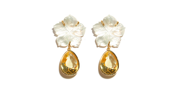 Full view of Paper White Dew Drop Earrings. Inject a shot of vitamin D into your wardrobe! These one-of-a-kind gold-plated earrings feature mother-of-pearl flower tops and lemon faceted glass drops that sparkle like warm sunshine.