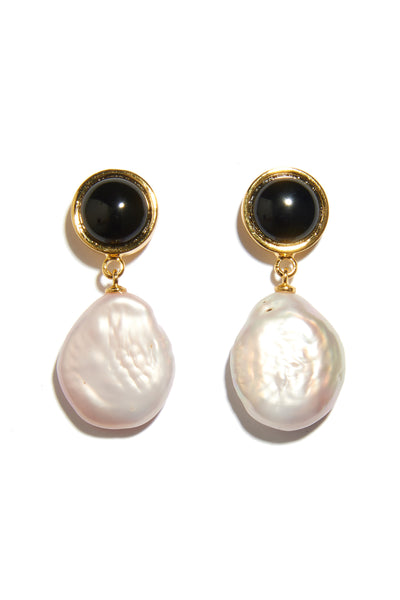 "Thumbnail close-up of Tuxedo Pearl Earrings In Light Pink. No need to wait for a black-tie event to don these one-of-a-kind ""tuxedo"" earrings; we love them paired with everyday classics like denim and a white tank. In gold-plated brass with onyx tops and hanging light pink baroque pearl drops."