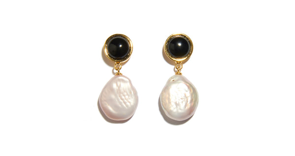 "Full view of Tuxedo Pearl Earrings In Light Pink. No need to wait for a black-tie event to don these one-of-a-kind ""tuxedo"" earrings; we love them paired with everyday classics like denim and a white tank. In gold-plated brass with onyx tops and hanging light pink baroque pearl drops."