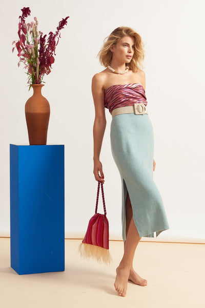 Thumbnail of model holding Gala Wristlet In Flamingo Stripe. Real talk: it doesn't get much ...