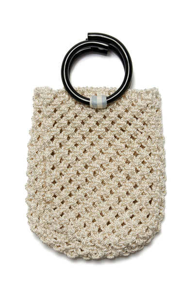 Thumbnail close-up of Mia Purse In Cream. We are so excited about our sophisticated take on the classic woven net bag. The Mia macrame purse in cream twist cord with black acrylic top handles is ready for city jaunts and beach strolls alike.