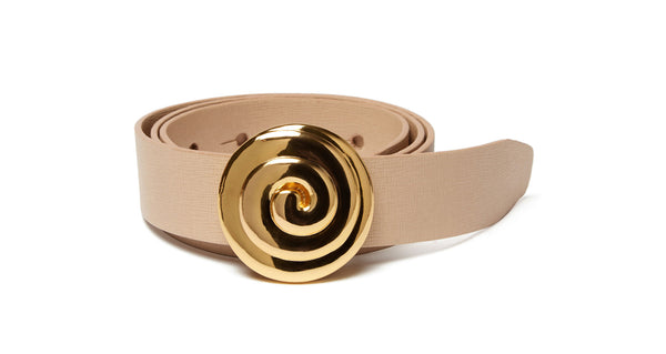 "Full view of Soleil Belt In Cream. You are getting very, very... stylish. Your outfit will be hypnotically cool in our wide nude-colored leather belt with gold-plated ""swirl"" buckle."