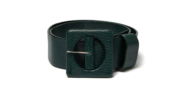 Full view of Agnes Belt In Forest Lizard. New season, new shape. Check out the impeccable detailing on our wide embossed leather belt with oversized square buckle, made in THE most gorgeous shade of deep green.