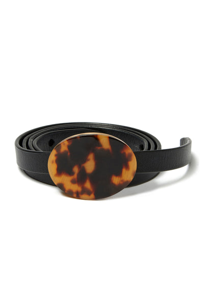 Thumbnail detail of Orbit Belt In Black And Tortoise. We don't like to play favorites, but this is one classic accessory we can't wait to wear with everything. Adjustable, skinny black leather belt with a chic tortoise-colored acrylic oval buckle.