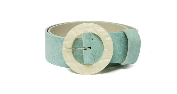 Full view of Louise Belt In Sky Blue. Poised to become a wardrobe essential, we're already wondering how we lived without this wide sky blue-colored suede belt with oversized, round acrylic buckle.
