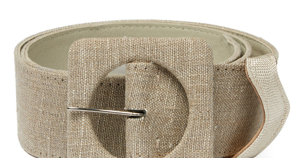 Close-up detail of Agnes Belt In Linen. New season, new shape. Check out the impeccable detailing on our wide natural linen and leather belt with oversized square buckle.