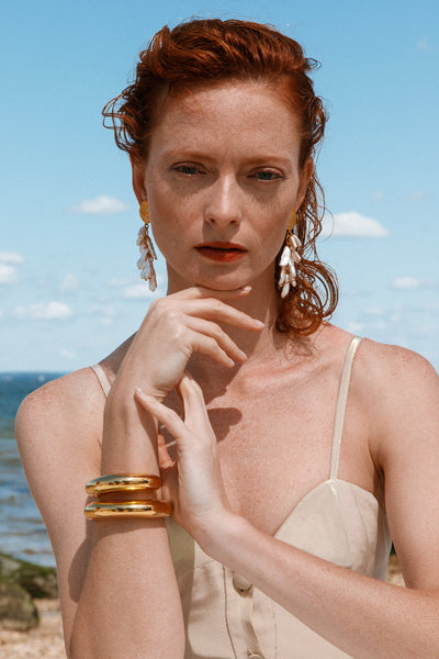 Thumbnail of model wearing the Ridge Cuff In Gold. How to make our essential thin peaked Rid...