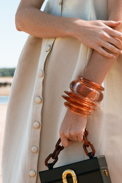 Thumbnail of model wearing the Arc Cuff in Sunset. Did someone say ombre?! Our new orange ac...